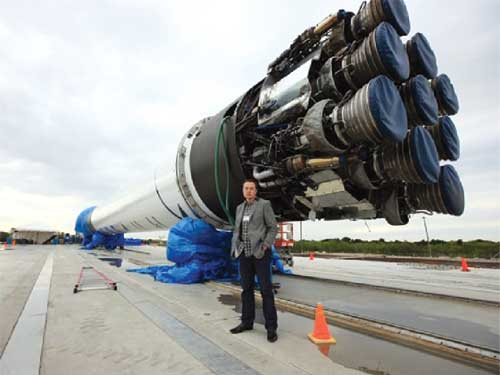 SpaceX founder, CTO and CEO Elon Musk stands with Falcon 9 at Cape Canaveral AFS.