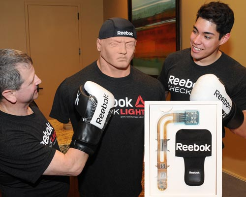 Gary Rabinovitz (left) and Carlos Bolanos demonstrate the Reebok Checklight, the winner in the advanced concept category. photo by Ed Winters Photography