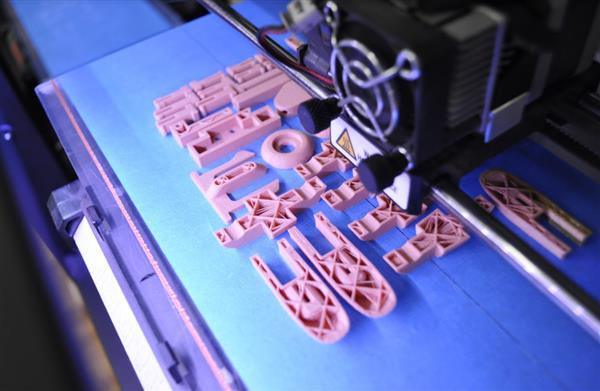 The team enlisted Voodoo Manufacturing's digital factory, composed of approximately 160 low-end 3D printers, in the hand drive effort. Image Courtesy of Voodoo Manufacturing