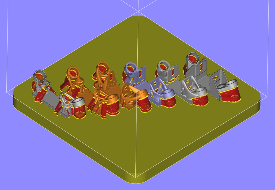 Metal parts laid out on build-plate, with support structures, for 3D printing. (Image courtesy Sintavia)