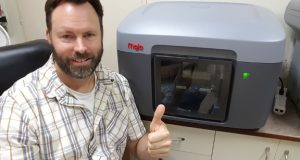 The 2016 Rapid Ready Sweepstakes winner Tom with the Stratasys Mojo printer he won.