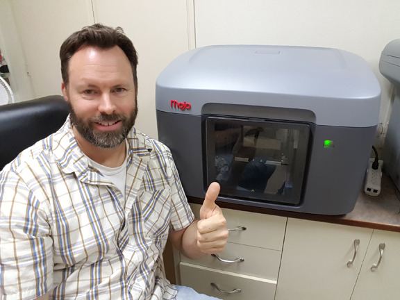 The 2016 Rapid Ready Sweepstakes winner Tom Helsley with the Stratasys Mojo printer he won.
