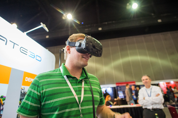 A Solidworks World attendee tries out VR experience in a partner's booth (image courtesy of Solidworks).