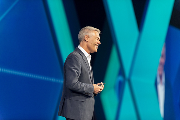 Hexagon CEO Ola Rollen, discussing the need to take a leap to survive the data avalanche, during his keynote at HxGN LIVE 2018 (image courtesy of Hexagon).