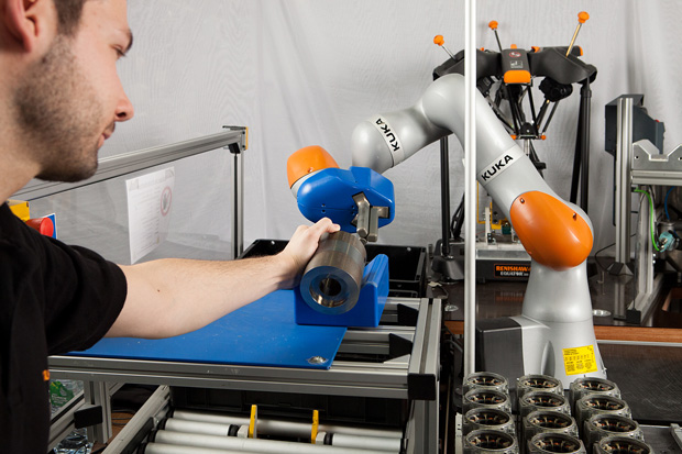 Siemens' Digital Factory division is advancing human-robot collaboration for more efficient electric motor production. Image courtesy of KUKA.