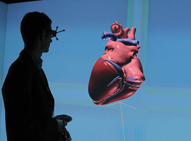Interacting with a virtual heart in a virtual cave, made possible in Dassault Systèmes' Living Heart Project. Image courtesy of Dassault Systèmes.