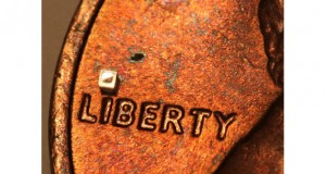 "Microtech's submillimeter sensor, dotting the ""I"" on a U.S. penny."