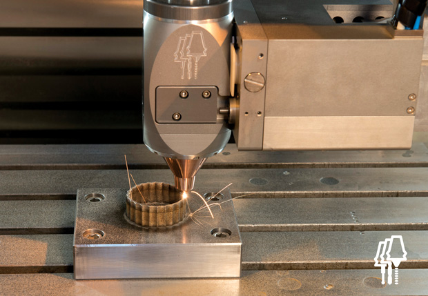Depositing (via direct metal deposition) a scalloped boss on a part, which will then be machined to a fine finish using the AMBIT multi-task hybrid docking system from Hybrid Manufacturing Technologies. Image courtesy of Hybrid Manufacturing Technologies.