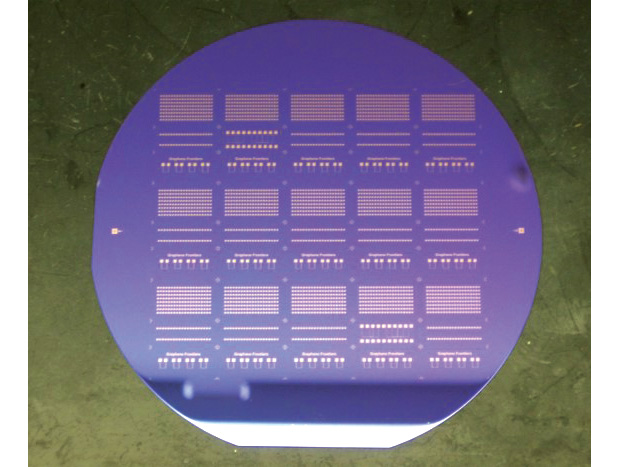 Graphene is just one of several new materials used in the fabrication of electronic components that promises to change the form and function of sensors. The wafer shown here contains graphene field effect transistors, which enable chemical and biological sensors to detect selective species. Image courtesy of Graphene Frontiers.