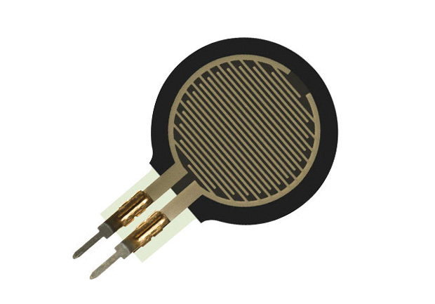 New printable inks allow sensor providers to manufacture ultra-thin devices in a range of sizes, shapes, and lengths. Shown here is Interlink Electronics' FSR 402 Short Force Sensing Resistor, which has a 12.7 mm diameter active area and is available in four connection options. Image courtesy of Interlink Electronics.