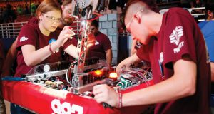 Students prepare their robot for the FIRST Championship. Image courtesy of Adriana Groisman / FIRST Robotics.