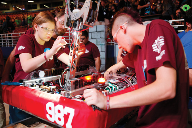 Students prepare robots for the FIRST Championship. Image courtesy of Adriana Groisman / FIRST Robotics.