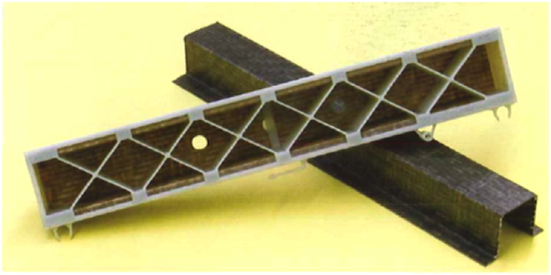 Fig. 1. A composite sheet product made by thermoforming and back injection