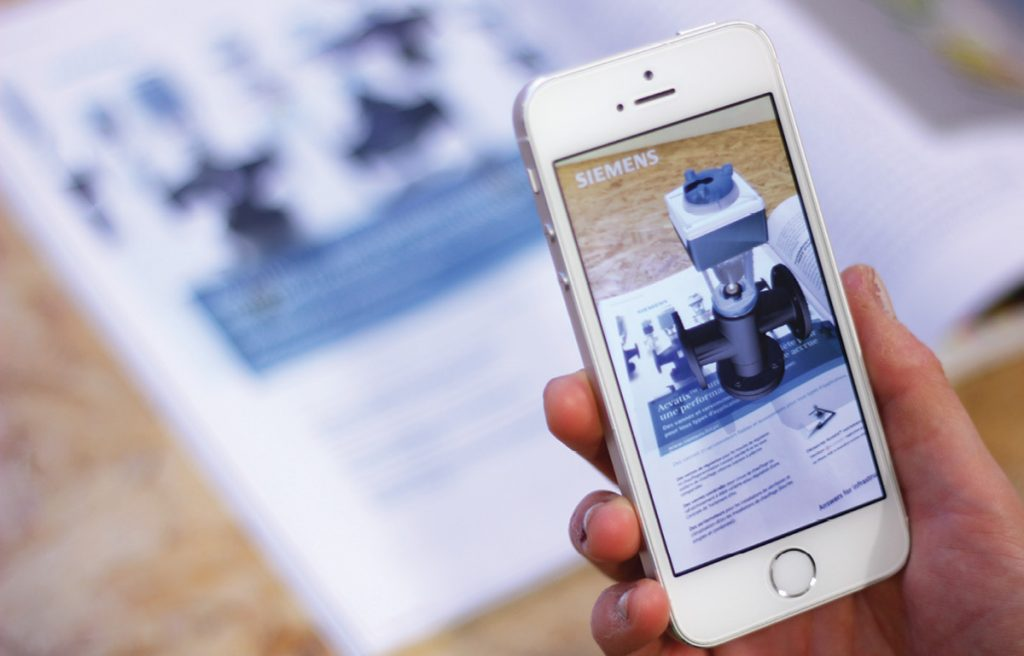 Augment offers enterprise augmented reality solutions for retailers and manufacturers. Shown here is a product by the manufacturing giant Siemens virtually imported into a mobile device's live camera feed via Augment's app. Image courtesy of Augment.