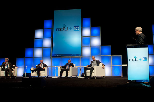 A panel discussion moderated by Mickey McManus (Autodesk/MAYA). Left to right: Fried Vancraen (Materialise); Greg Morris (GE Aviation); Vyomesh Joshi (3D Systems); Stephen Nigro (HP). Image courtesy of Michael Drazdzinski.