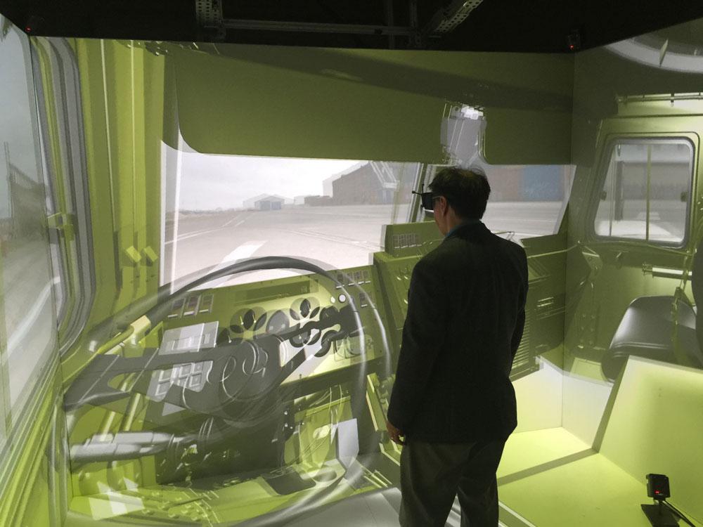 DE Editorial Director Jamie Gooch prepares to take the wheel of a front-end loader.