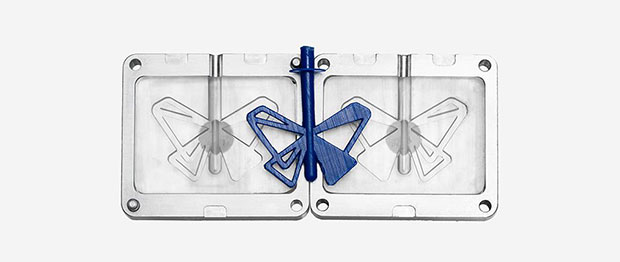 The molds in the aluminum frames that were used to injection-mold the plastic blue butterfly were 3D printed on a Form 2 desktop stereolithography (SLA) 3D printer. Image courtesy of Formlabs Inc.