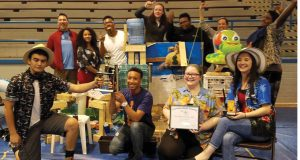 Rube Goldberg Machine Contest participants pose with their machines. Image courtesy of RGI.