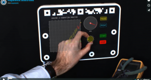At the top of this SmartPanel is machine-readable code that's scanned to identify the panel and set the user's operating limits. Users wearing smart glasses interact with virtual knobs, buttons and other widgets using single or multiple finger gestures. Screen capture courtesy of Augumenta Ltd.
