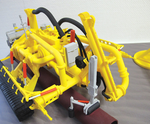 Seatools, a subsea technology company, builds key scale models of its machinery designs using 3D Systems SLS 3D printing with the Duraform PA nylon materials. On completion of the prints, the models are sanded and painted for the company's trade shows and marketing. Image courtesy of 3D Systems.