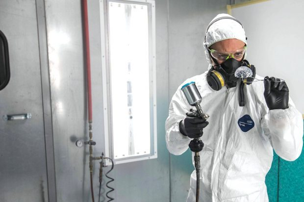 A finisher applies clear coat to a stereolithography part. Image courtesy of Proto Labs.