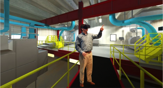 Fig. 7: An engineer using a VR HMD inside a CAVE. (Join Gray Construction)