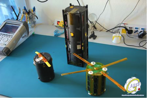 Fig. 8: Integration of the TubeSats into the TuPOD by the GAUSS team in Rome. Image courtesy of GAUSS srl.