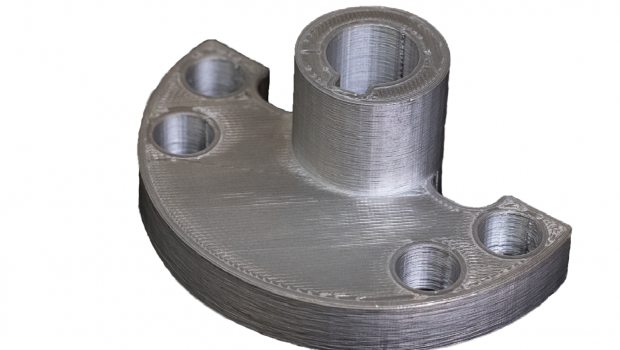 This metal flange printed on a Metal X 3D printer is a part of a wheel shaft assembly designed as an alternative to an original part that is inefficient in machine time and material costs to make. Image courtesy of Markforged Inc. and Stanley Infrastructure.