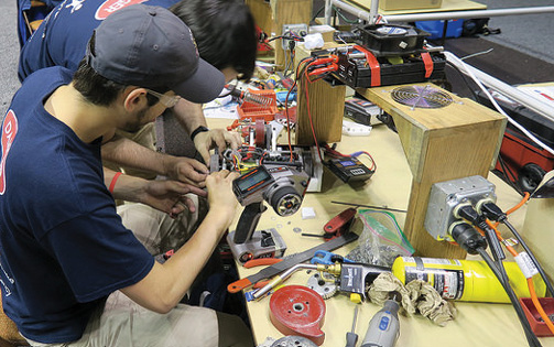 Students can attempt to fix damaged bots in pitstop-like breaks in the National Robotics League competition.