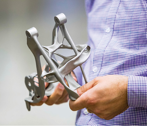 GM and Autodesk partnered to explore the use of generative design technology to redesign a seat belt bracket. Image courtesy of Autodesk.