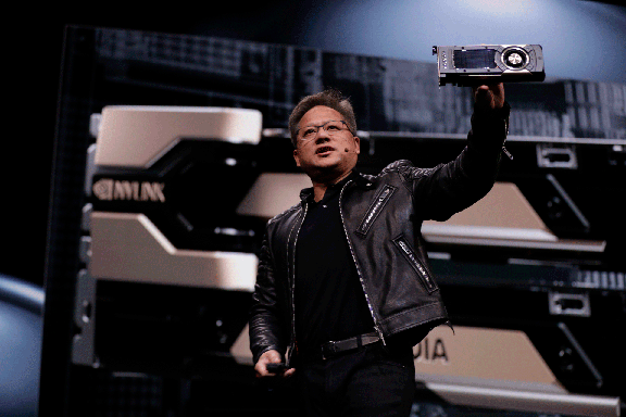 NVIDIA CEO Jensen Huang showcased the new GPU Quadro GV100, based on Volta architecture, at the year's GPU Technology Conference. Image courtesy of NVIDIA.