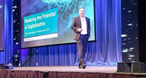 Siemens PLM Software CEO Tony Hemmelgarn takes the stage at Siemens PLM Connection 2018 to talk digitalization and integration. Image courtesy of Jess Lulka.
