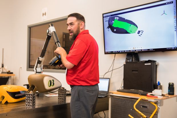 Scanning a motorcycle piece with the ROMER Absolute Arm. Image courtesy of Exact Metrology.