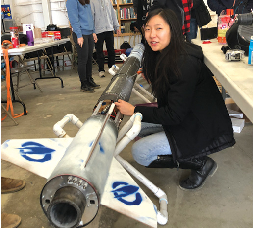 A UCLA student with a liquid fuel rocket. Image courtesy of Base 11.