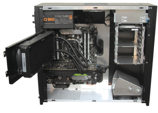 The interior of the case is spacious, but users must swing the cooling radiator out of the way to access the CPU and memory sockets. Image courtesy of David Cohn.