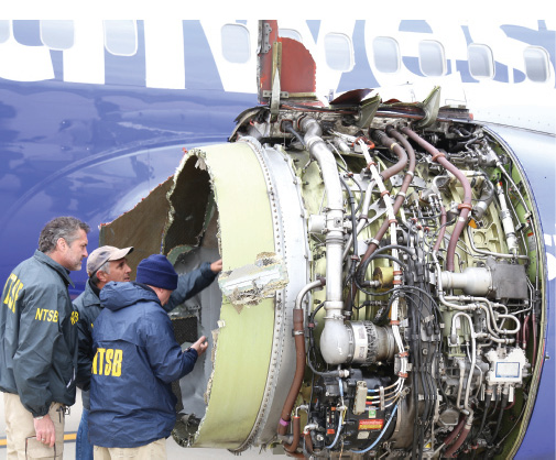 National Transportation Safety Board investigators examine the engine of Southwest Airline flight #1380. Image courtesy of NTSB.