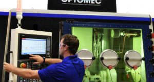 The LENS 860 Hybrid Controlled Atmosphere System from Optomec, with a larger work envelope and higher powered lasers, provides more capabilities for metal hybrid additive manufacturing. Image courtesy of Optomec.