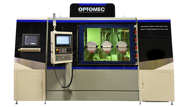 The LENS 860 Hybrid CA system is equipped with a hermetically-sealed build chamber that maintains oxygen and moisture levels below 40 ppm for processing reactive metals, such as Titanium. Image courtesy of Optomec.