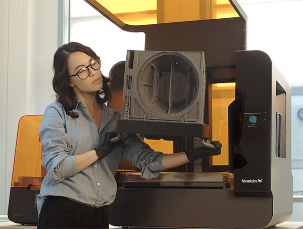 A speaker print being removed from the new FormLabs Form 3L. Image courtesy of FormLabs.