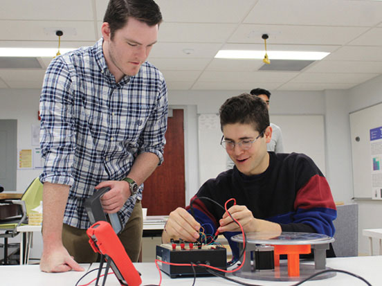Students at Penn State University's THRED lab evaluate a product design. Image courtesy of Penn State University.