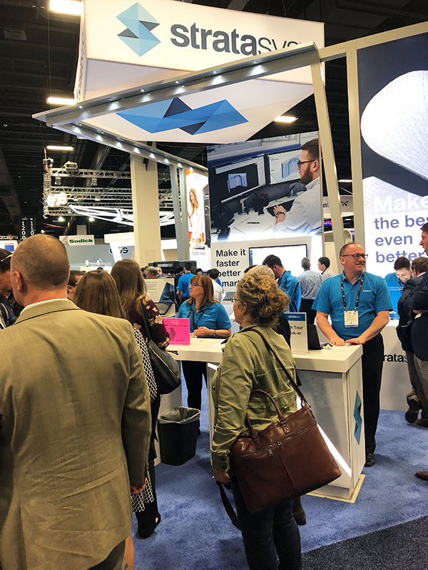 Attendees near the Stratasys booth at the 2018 Rapid + 2018 show.
