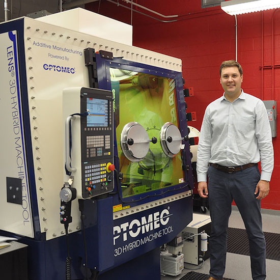 Michale Sealy, University of Nebraska-Lincoln, with Optomec 3D printer.